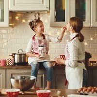 Mother Daughter baking in kitchen 200x200
