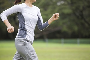 Woman running outside 300x200